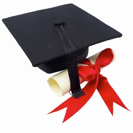 Close up of a graduation cap and a certificate with a ribbon